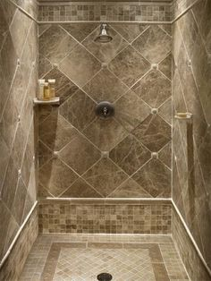 master bathroom shower using the idea of clipped corners milano cappuccino tile with marazzi romancing the stone 2 x 2 tile