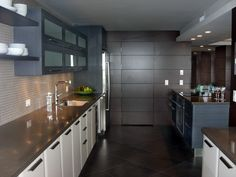 Dark Tile Flooring and Blue Cabinetry