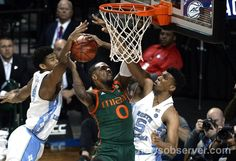 UNC forward Tony Bradley (5) blocks a second half shot by Miami guard Ja'Quan Newton (0) in the second half with help from teammate forward Isaiah Hicks (4) during the ACC Men's Basketball Tournament at the Barclays Center in Brooklyn, N.Y. Thursday , March 9, 2017.