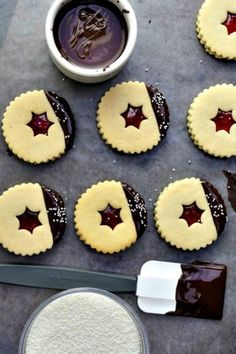 Chocolate-Dipped Linzer Cookies: You didn't think we were going to forget to include a chocolate twist on Linzer cookies, did you? Enjoy these chocolate dipped linzer cookies as Christmas dessert. Find more easy and delicious linzer cookie recipes and ideas for Christmas here.