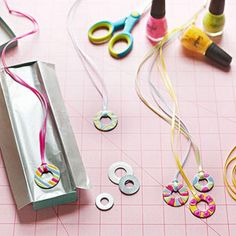 use washers and ribbon - paint washers or wrap with embroidery thread in the oclors of your choice. Use the ribbon for the necklace.