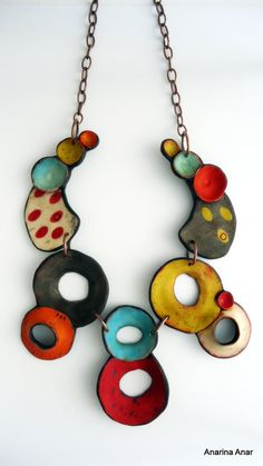 Polymer clay necklace. - Unique organic shape. - Length from top to bottom: 30 cm. - The ring through which the T-bar is secured, is on the right side of the necklace. ........................................................................................................ Visit my shop to see more of my work. Polymer clay is a magical medium and has endless possibilities! My inspiration is color driven with earthy, organic shapes. I find it fascinating to think of people around the world…