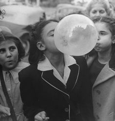 A young girl blowing a large bubble gum bubble (1946) by Bob Landry