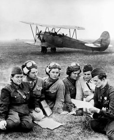 Soviet Squadron commanders of the 588th Night Bomber Regiment, 4th Air and Air Defence Forces Army, Soviet Air Forces, are photographed in a briefing during the Battle of the Caucasus. Behind them can be seen a Polikarpov Po-2 biplane. The 588th Night Bomber Regiment was created in October 1941 by Col. Marina Raskova and led by Major Yevdokia Bershanskaya, and was made up entirely of young female volunteers.