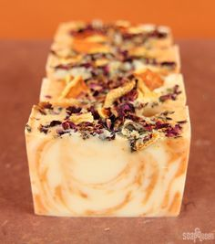 Juicy Orange & Sweet Rose Cold Process - Soap Queen I'm a huge fan of fancy swirled tops, but for this recipe I decided to switch things up. This orange-scented soap is piled high with orange peels and rose petals, … Handmade Soap Recipes, Soap Making Recipes, Handmade Soaps, Diy Cosmetic, Savon Soap, Soap Packaging, Homemade Beauty Products, Natural Products, Goat Milk Soap