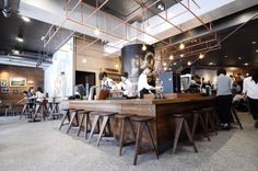 Designed as a theatre for coffee, this Starbucks store in Taipei's Longmen building features a Reserve Bar that acts as center stage. Centrally located, the bar is visible all throughout the store. Artwork in the store includes a marquetry, made with...