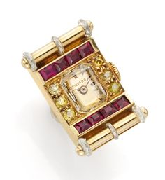 Van Cleef & Arpels. A Retro Yellow Diamond and Ruby Ring Watch, by Van Cleef & Arpels. Available at FD Gallery. www.fd-inspired.com.