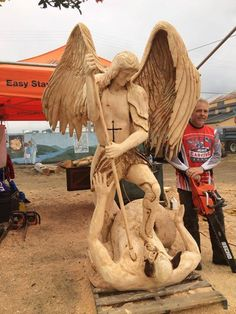 ECHO Chainsaw Carving Team member Bob King just finished this majestic statue of Arch Angel Michael defeating Satan.