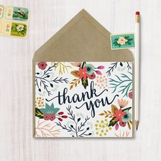 A boxed set of thank you cards with a floral design. Each card comes with a kraft brown envelope with a triangle flap.  This listing is for a set of cards (please specify under number of cards). The inside is left blank for your personal message.  -Card Size: A2 (4 1/4 x 5 1/2) -Printed on thick 100 pound smooth white cardstock. -Each card comes with a matching size (A2) envelope.  All sets of cards come in a clear plastic card box.  *Matching invitations and recipe cards are sold…