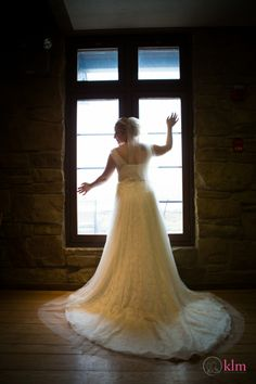 wedding dress in window - KLM Photography - Allison Peabody Hall - Abe Martin Lodge - Brown County State Park