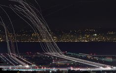 SO cool!  Airplanes photographed using a long exposure... this is probably my favorite, but the others on this site are really good too!