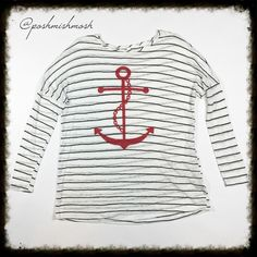 Black Striped Anchor Lightweight Sweater Tunic Beautiful lightweight sweater is perfect for you summer outings. 60% Poly, 40% Rayon. I recommend a camisole underneath. The stripes are black and the anchor is red.  Made In USA 29' long. Sweaters