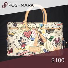 Dooney and Bourke Purse Disney print bag, used once or twice, comes with shoulder strap Dooney & Bourke Bags Satchels