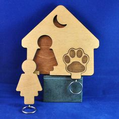 This keyring and lead holder make a lovely gift for ladies who love their dog. Just place your keys on one Keyring and your dogs favourite lead on the other.  A Girls Best Friend Keyrings with house shaped wall mounted holder. The assembled unit measures approx. 140mm X 140mm X 12mm and is supplied with wall fixings.  The 2 point fixation ensures holder stability when there is only a single keyring fitted to the holder.  The holder can be personalised with names, numbers or initials on each…