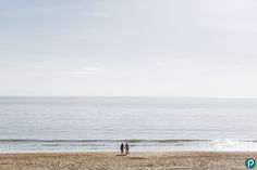 Creative and romantic couple portraiture, pre wedding photo shoot on the beach in Dorset.    Wedding photographer and photojournalist in Dorset.