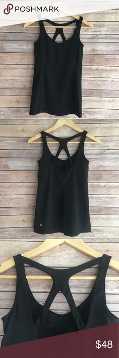 Lululemon Optimal Tank Lululemon Optimal Tank, double straps with cutouts on the back. Shelf bra with medium support. Slight pilling, and a tiny snag on the front of the tank but not very noticeable. Size 6. lululemon athletica Tops
