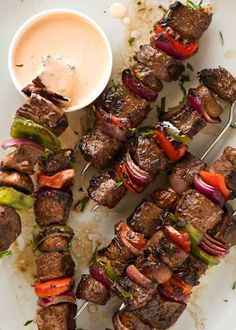 Overhead photo of Marinated Beef Kabobs with a pink sauce