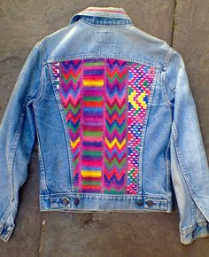 Wonderfully colourful fabric which appears to have been hand woven, used to decorate the back panel of this Levis' jacket.