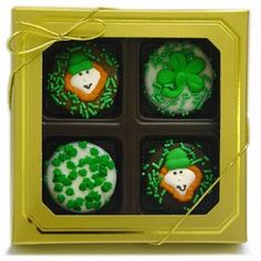 Belgian Chocolate St. Patrick's Day Oreos®- Gold Box of 4    These delicious Oreo® Cookies are a sweet token for those of all ages! Wrapped in your choice of decadently delicious fine gourmet Belgian Chocolates--Dark, Milk or White--and decorated with hand-crafted Royal Icing Leprechauns and Shamrocks and assorted Saint Patrick's Day Candy Sprinkles.