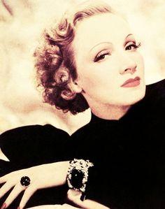 Marlene Dietrich wearing Mauboussin emerald and diamond jewelry.
