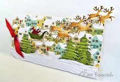 11/25/2013; Kittie Caracciolo at 'KittieKraft' blog; a great Christmas tag using Impression Obsession Santa and Fir Trees.  Good photo tutorial included!!!