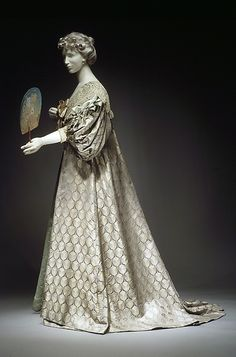 1894 Tea gown by House of Worth. The sleeves and collar of this teagown reference the early 17th century, which was a common period for Worth to draw from. Although it appears to be a loose garment, the understructure is boned. Even though the garment would not have required such structure for its use, women were often more comfortable when retaining their armor.