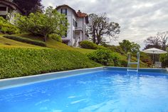 Chic villa with pool in Laveno overlooking Lake Maggiore, Italy Lake Maggiore Italy, Holiday Rentals, Northern Italy, Luxury Villa, Vacation, Outdoor Decor, House, Luxury Condo, Haus