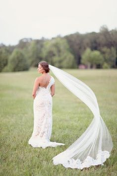 check out that veil! (oh & the very gorgeous dress too ~ it's my wedding dress of the week)