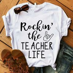Teacher outfits Rockin the Teacher Life Your Wedding Theme Whether it's a traditional, formal o Teaching Shirts, Teaching Outfits, Student Teaching, Vinyl Shirts, Tee Shirts, Work Shirts, Teacher Style, Mode Style, Direct To Garment Printer