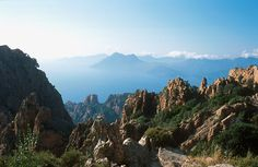 The Calanche of Piana is one of Corsica's marvels. It is a series of jagged red rock canyons near the gulf of Porto. A road has been built through it, making its access easier. Unfortunately, it also made the area quite noisy because of the habit of corsican truck drivers to sound their horns when they cannot see what's ahead of them.