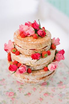 """pretty """"naked"""" cake looks like a cream frosting with jam between layers"""