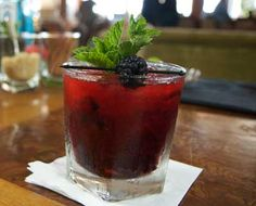 Lost In Paradise cocktail served at Casa del Mar in Santa Monica. Mixologist Aidan Demarest combines rum, cointreau, fresh lime, blackberries and mint. #cocktail #recipe