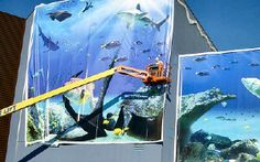 TS44 Building Graphic - Here, the vinyl graphic is stretched, on the entrance of an aquarium Center, on a TS44 frame. Tensioning Solutions' banner stretching system is the simplest and cost-effective way to answer the question: How to tight any sizes banners?