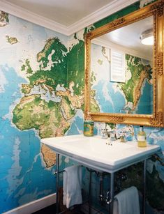 World map mural/wallpaper in a bathroom via Apartment Therapy