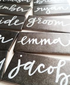 Modern calligraphy on textured slate grey tile by Sea Calligraphy.
