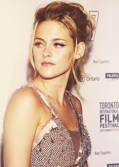 She's actually gorgeous I just wish she would smile more!