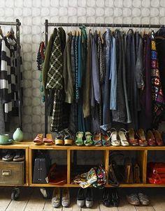 shelves on wheels. exposed closet.