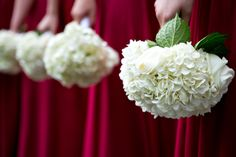 Solid white bridesmaid bouquets were stunning with their red dresses! Check out our website to see more of our beautiful weddings and events! idoidoweddingplanning.com