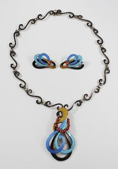 Necklace & Earrings | Margot de Taxco.   Sterling silver, black enamel with bright red, blue and yellow accents. ca. 1960s.