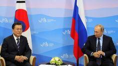 Russian President Vladimir Putin, right, look at South Korean President Moon Jae-in during their meeting at the Eastern Economic Forum in Vladivostok, Russia, Wednesday, Sept. 6, 2017. (Mikhail Klimentyev, Sputnik, Kremlin Pool Photo via AP)