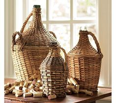 Love these woven wicker wine bottles from Pottery Barn..