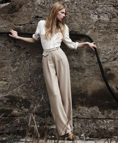 Such a fantastic outfit, down to the necklace and braid in her hair. Shirt and pant by Maison Martin Margiela