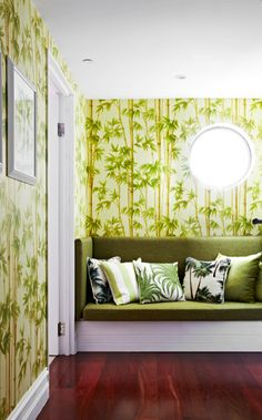 Take a trip to the tropics with this unforgettable hallway. The porthole window mimics the sun, beaming through the patterned wallpaper. The green on green enhances the light in the room, for a truly innovative space. Image: Livingetc