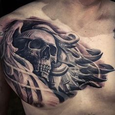 Large 3D style detailed chest tattoo of human skull with clock and wings