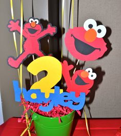 My daughter had an Elmo birthday party.  It was absolutely perfect and turned out better than I imagined.  http://www.etsy.com/shop/paigerob...