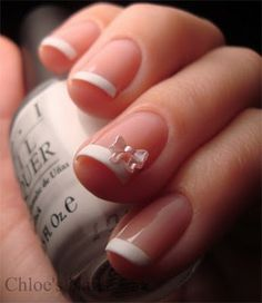 Step one: Stop bitting my nails! Step two: French manicure with a glued on bow! so presh.