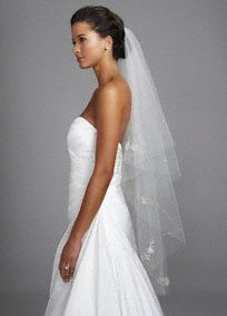 Make your walk down the aisle one for the books in this absolutely beautiful veil!  Veil fatures flower motif and cut edge.  Pairs beautifully with any wedding dress but made for Style CPK512.  Available in Ivory and White.  Imported.