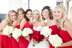 red dresses with white bouquets, bride with red bouquet Winter Bridesmaid Dresses, Winter Bridesmaids, Bridesmaid Duties, Bridesmaid Flowers, Brides And Bridesmaids, Red Wedding, Wedding Bells, Wedding Flowers, Wedding Sweepstakes