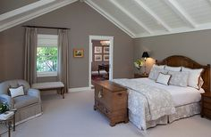 Grey walls add refinement to the room with slanted ceiling Savvy Design Ideas That Help Make The Most Of Slanted Ceilings