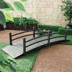 ***FREE SHIPPING*** Its graceful design and generous size ensure this 8-Ft Outdoor Garden Bridge with Handrails in Weather Resistant Dark Wood Stain will enhance the look of your secret garden oasis